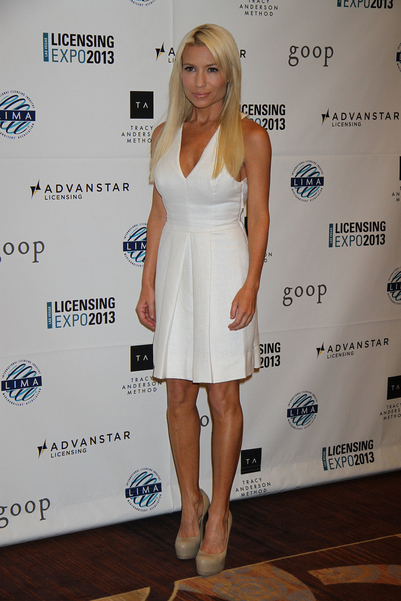 tracy wore a white dress and neutral colored