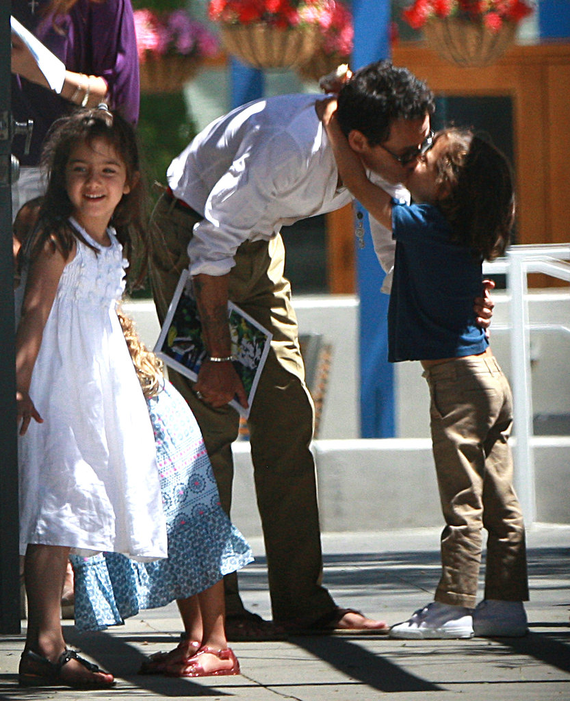 Marc Anthony gave a kiss to son Max.