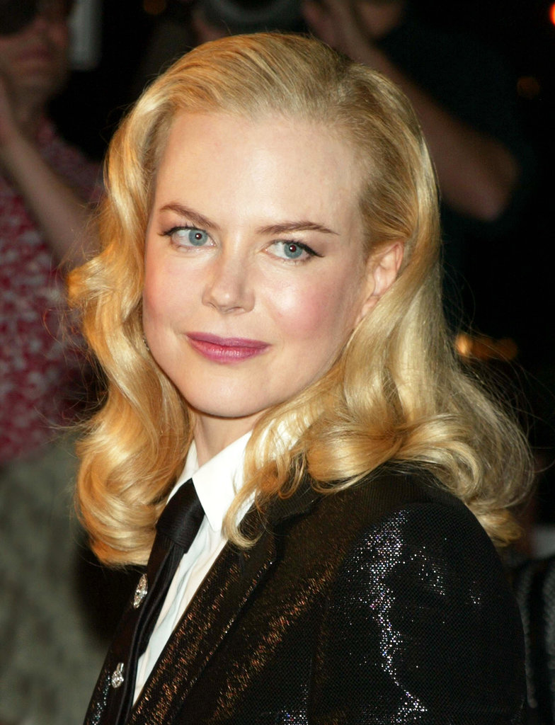 Back in 2003, Nicole was at the NY premiere of The Human Stain wearing her blonde hair in glamourous vintage waves. She paired the feminine look with a tux for a modern twist.