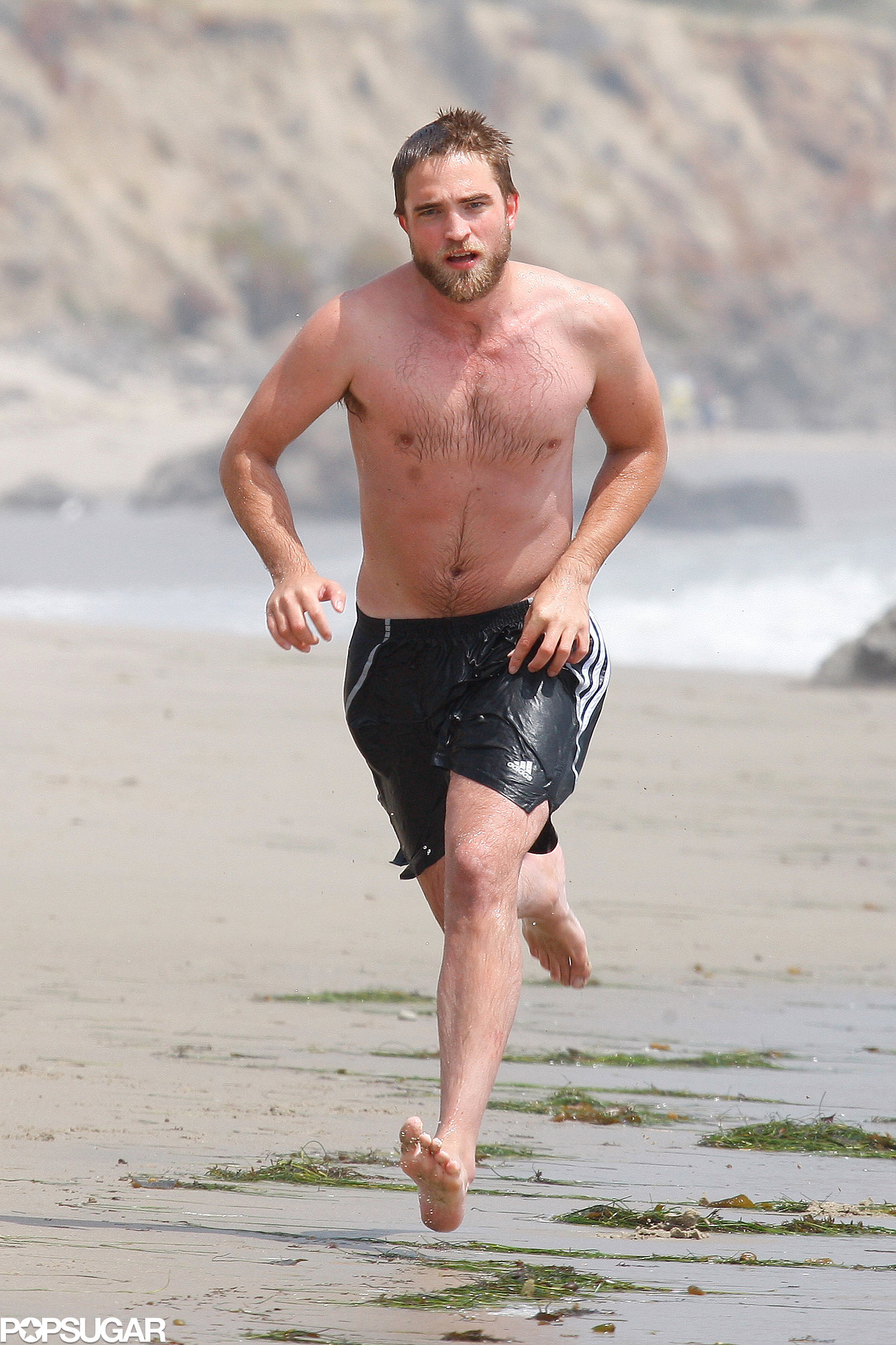 Robert Pattinson and his muscles hit the sand in Malibu in March 2012.