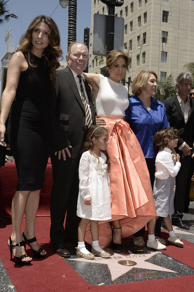 Jennifer Lopez cuddled up to her family at the Walk of Fame ceremony on Thursday.