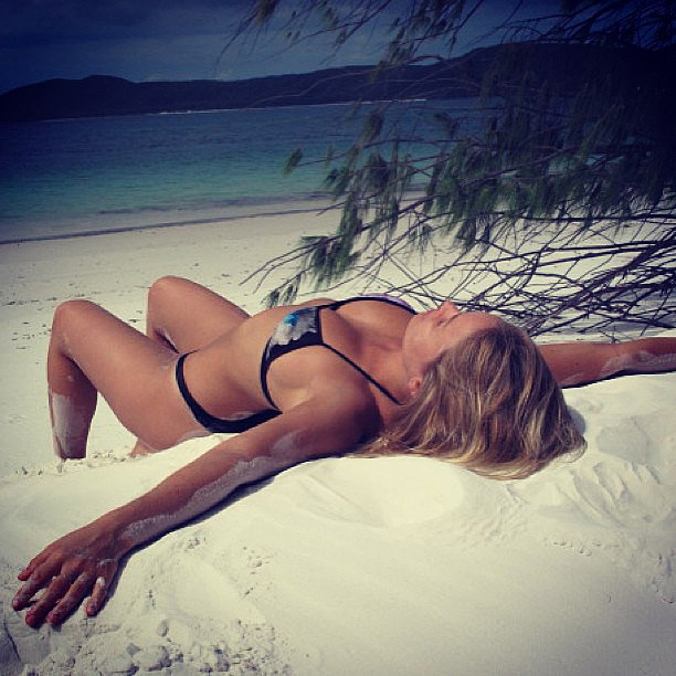 Lara relaxed on the white sand of Hamilton Island. Source: Instagram user mslbingle
