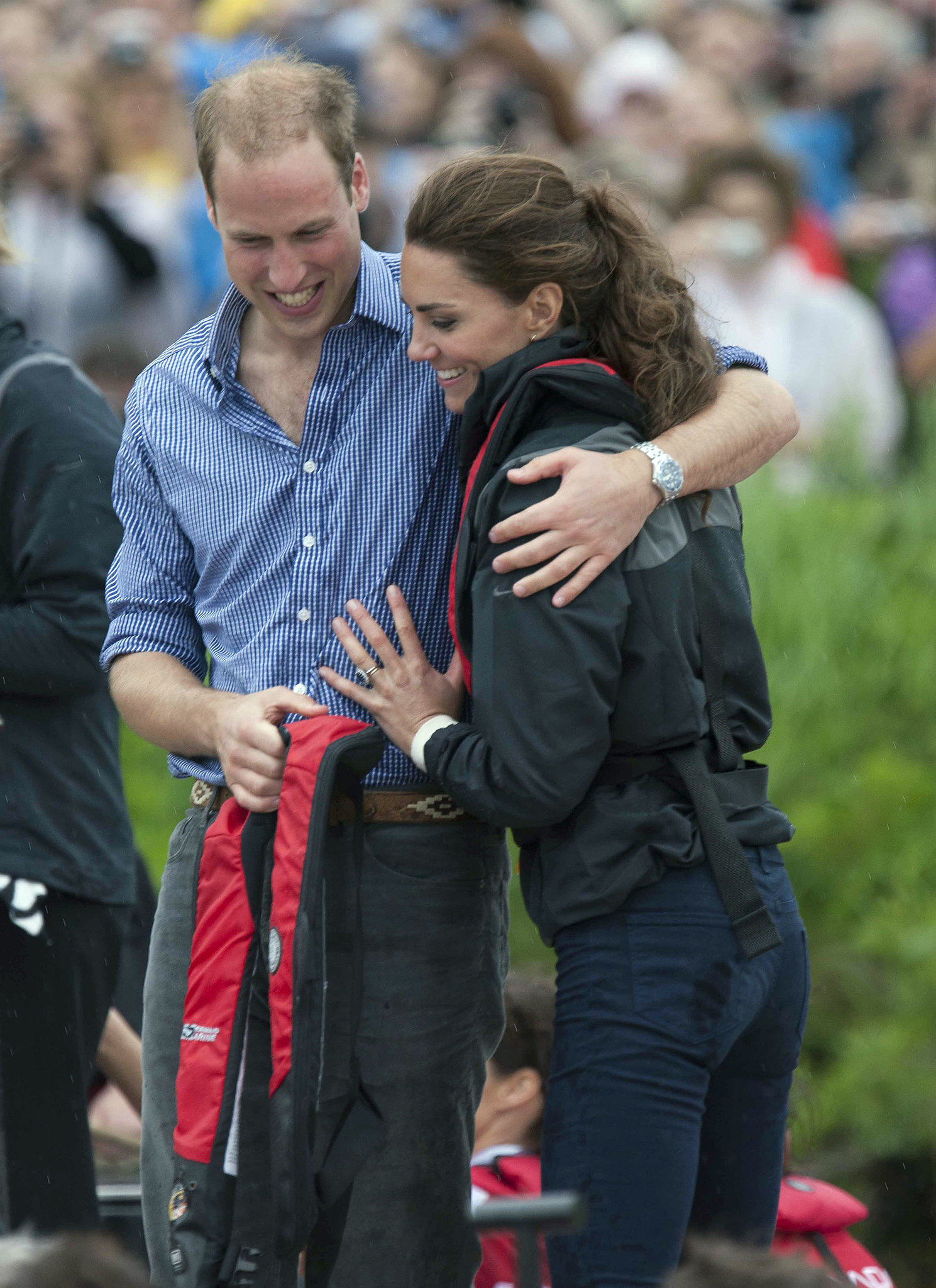 In July 2011, William wrapped Kate in a hug