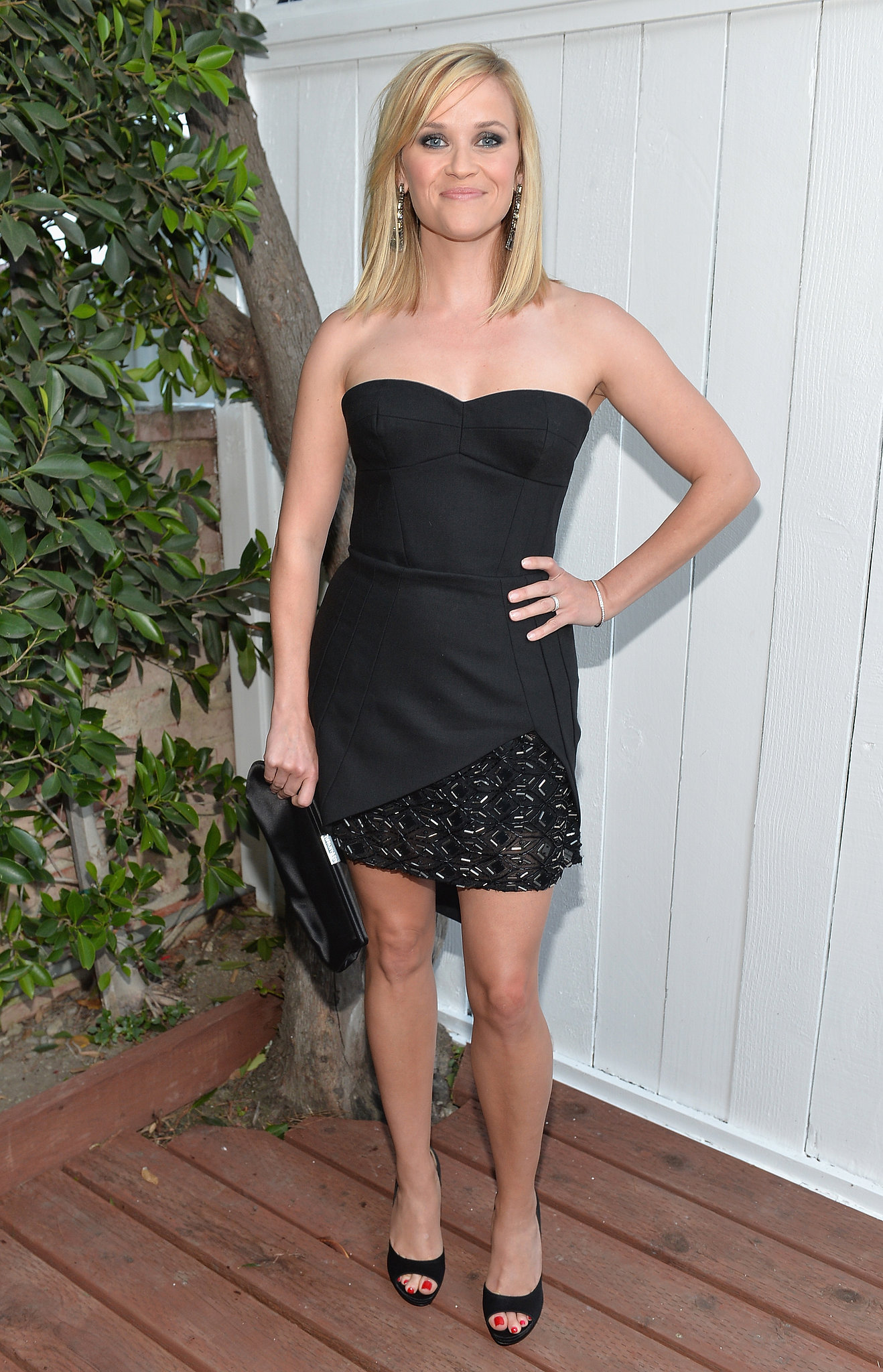 Reese Witherspoon donned the sexiest kind of LBD — one with a sweetheart neckline and embellishments — to Benjamin Millepied's LA Dance Project inauguration benefit gala in LA in June 2013.