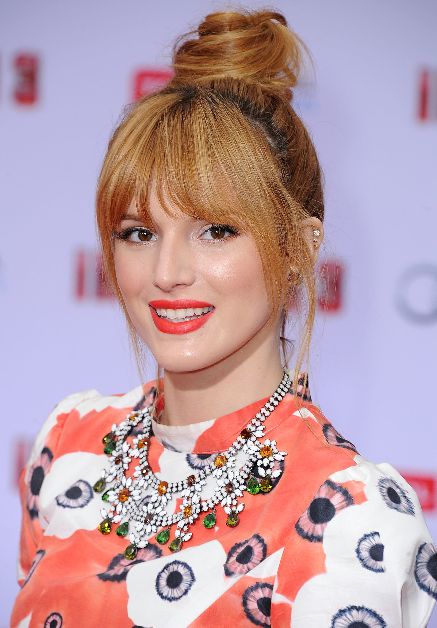 A fiery orange lip hue, just like Bella Thorne's, is the ideal complement to a twisted topknot. Both make a statement and are right on trend for Summer 2013.