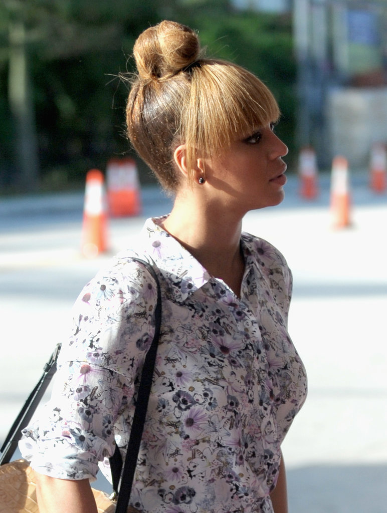 Beyoncé Knowles left her blunt bangs out for this easy topknot look.