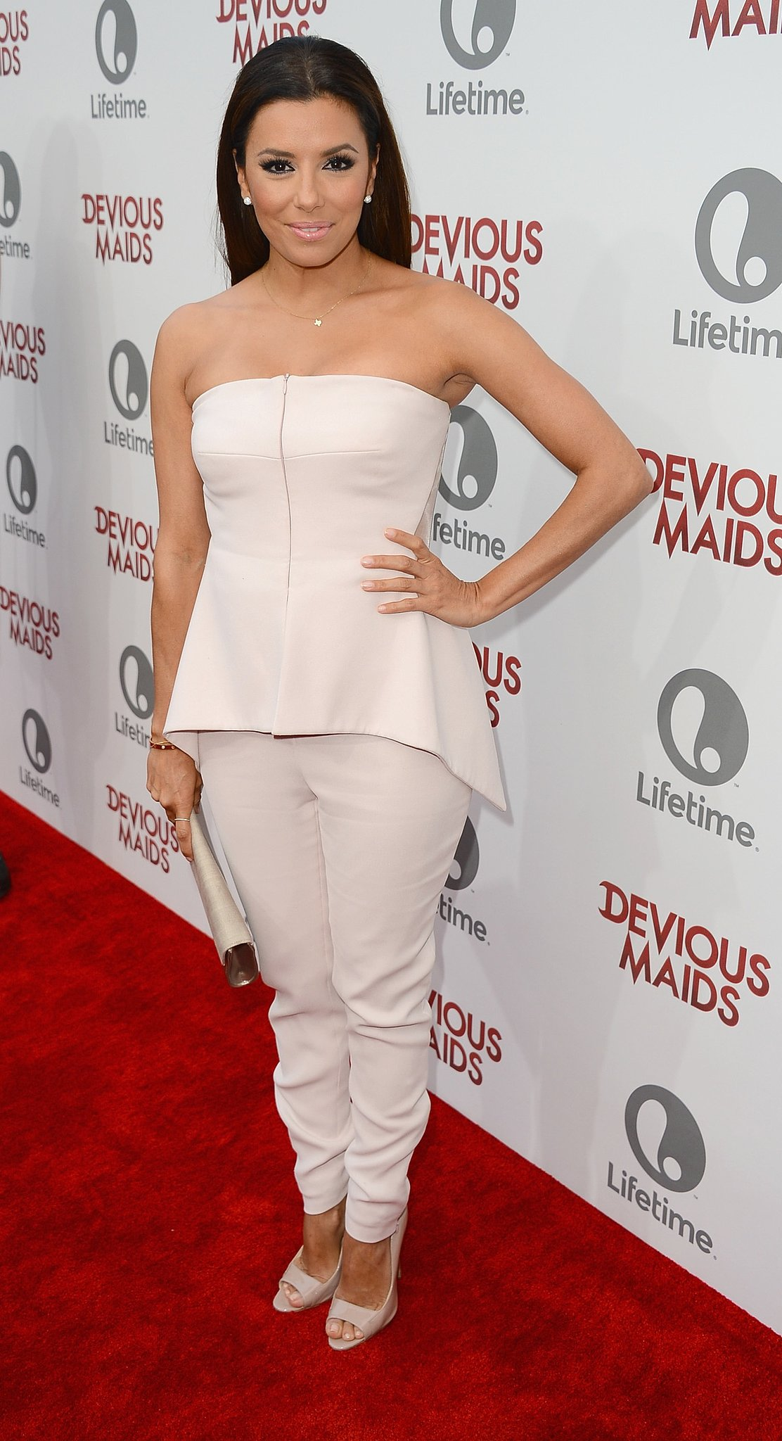Eva Longoria opted to ditch a dress and instead donned a strapless top and matching trousers at the premiere of Devious Maids in Beverly Hills, CA.