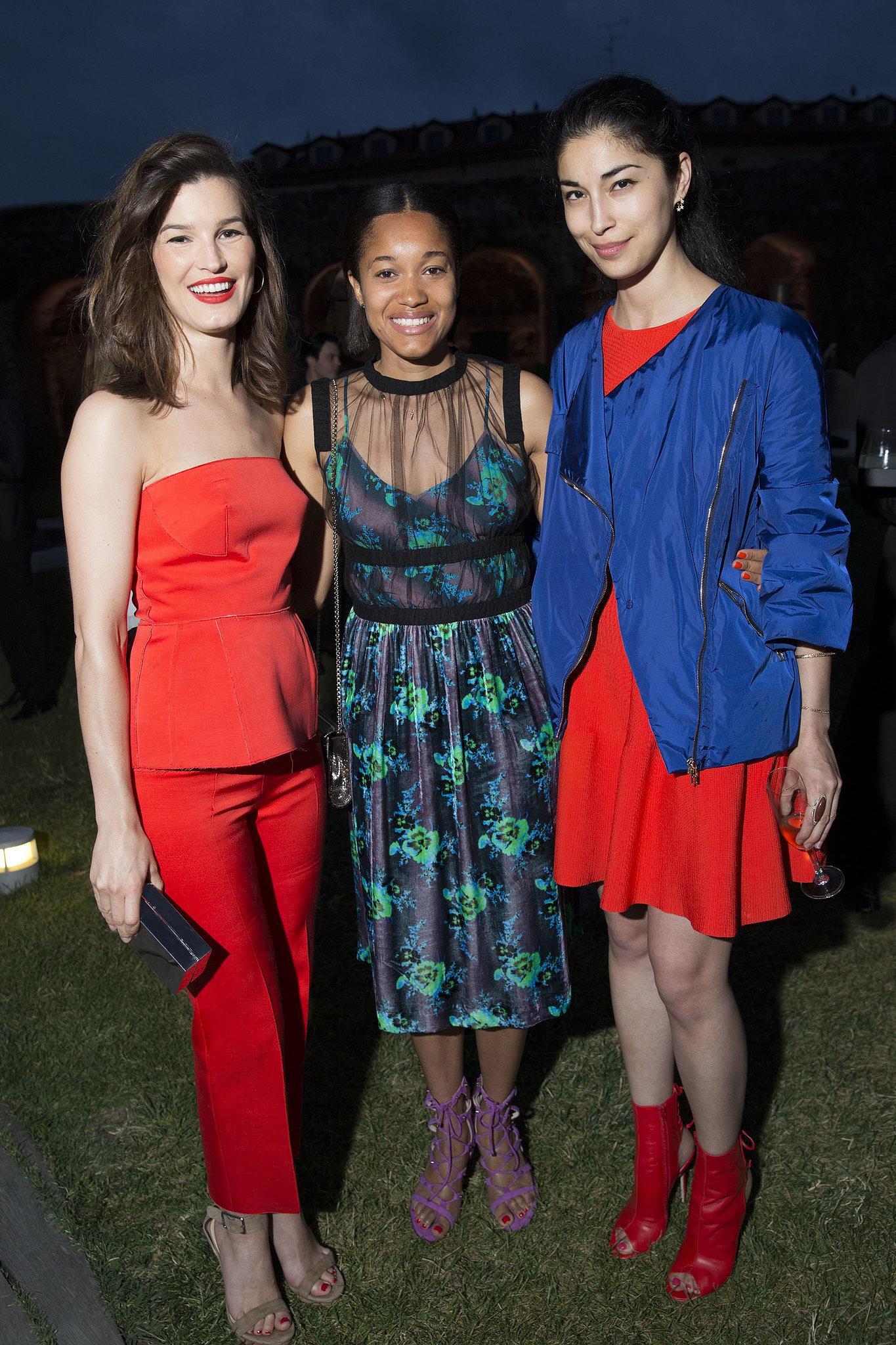 Hanneli Mustaparta, Tamu McPherson, and Caroline Issa at the Calvin Klein Collection dinner in Milan.