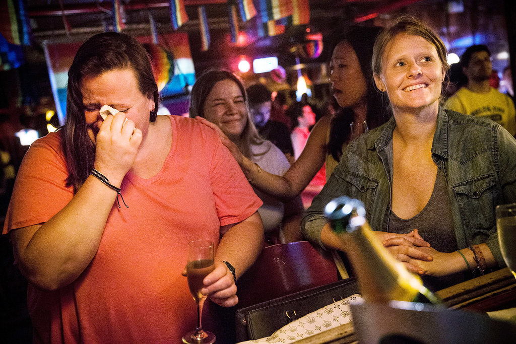Gay rights supporters in NYC cried after watching the news that the US Supreme Court ruled DOMA unconstitutional.