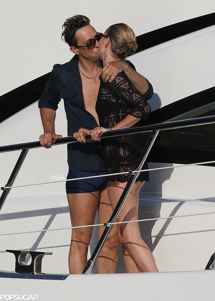 The newlyweds shared a steamy kiss on the deck of Sir Philip Green's yacht during their July 2011 honeymoon in Corsica, France.