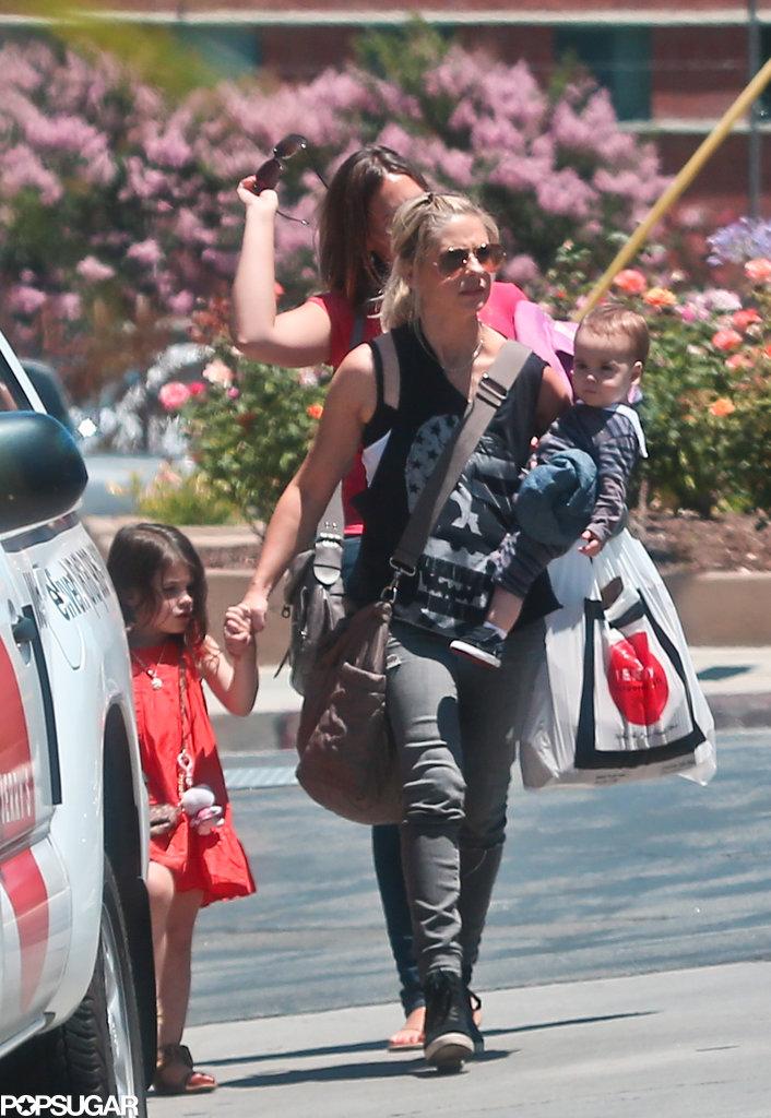 Sarah Michelle Gellar held onto daughter Charlotte Prinze's hand.