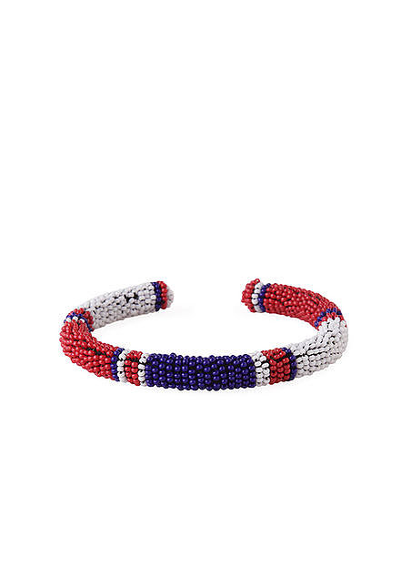 Unsure about what constitutes too much red, white, and blue? Get the tiniest dose possible with Isabel Marant's beaded bangle ($190).