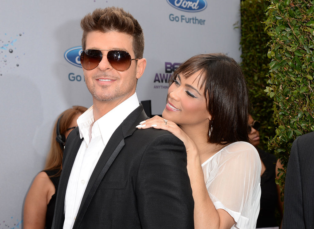 Robin Thicke and Paula Patton shared a cute moment on the red carpet.