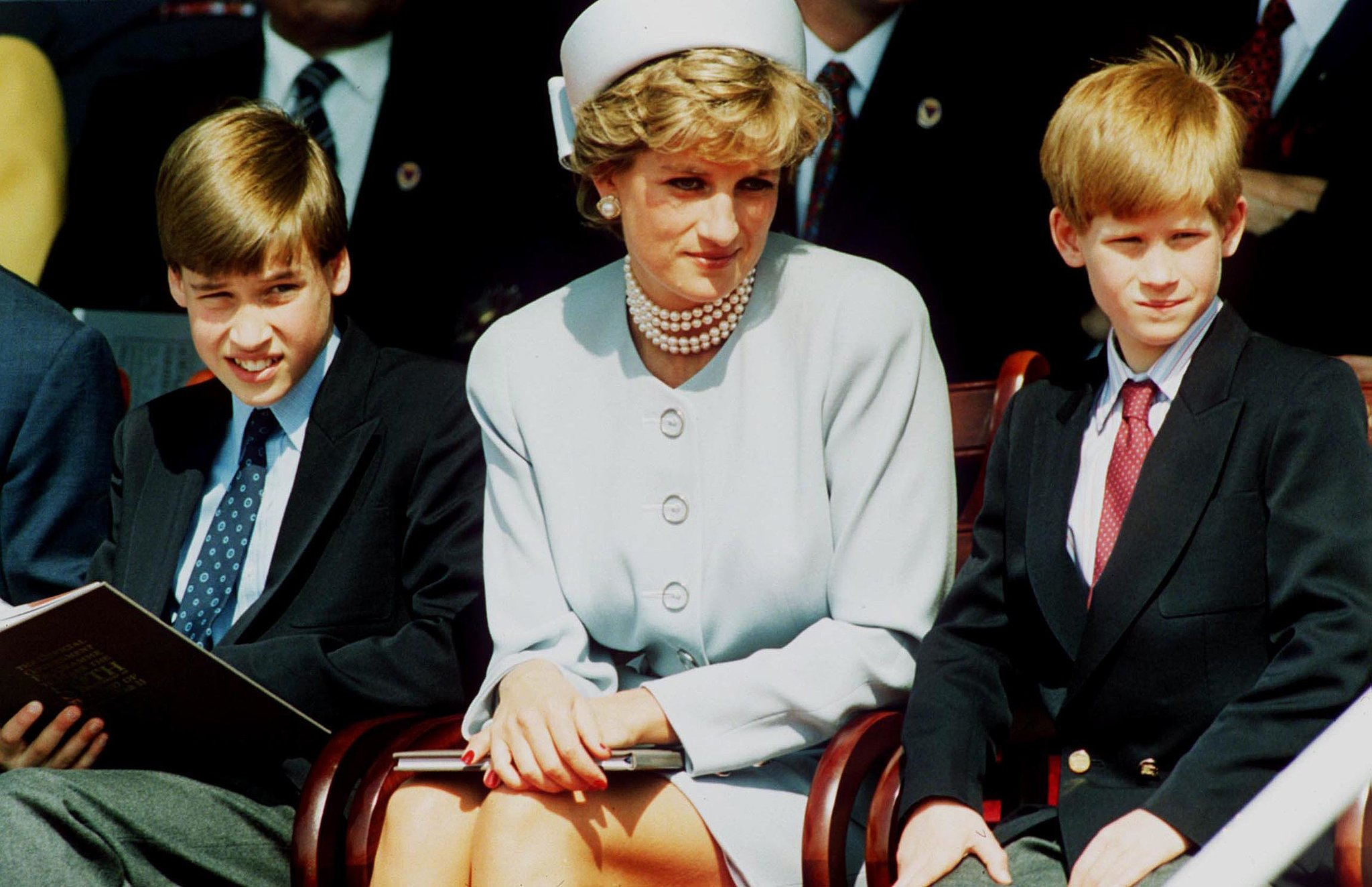 Princess Diana sat between her sons, Prince William and Prince Harry, during a May 1995 event in London's Hyde Park.