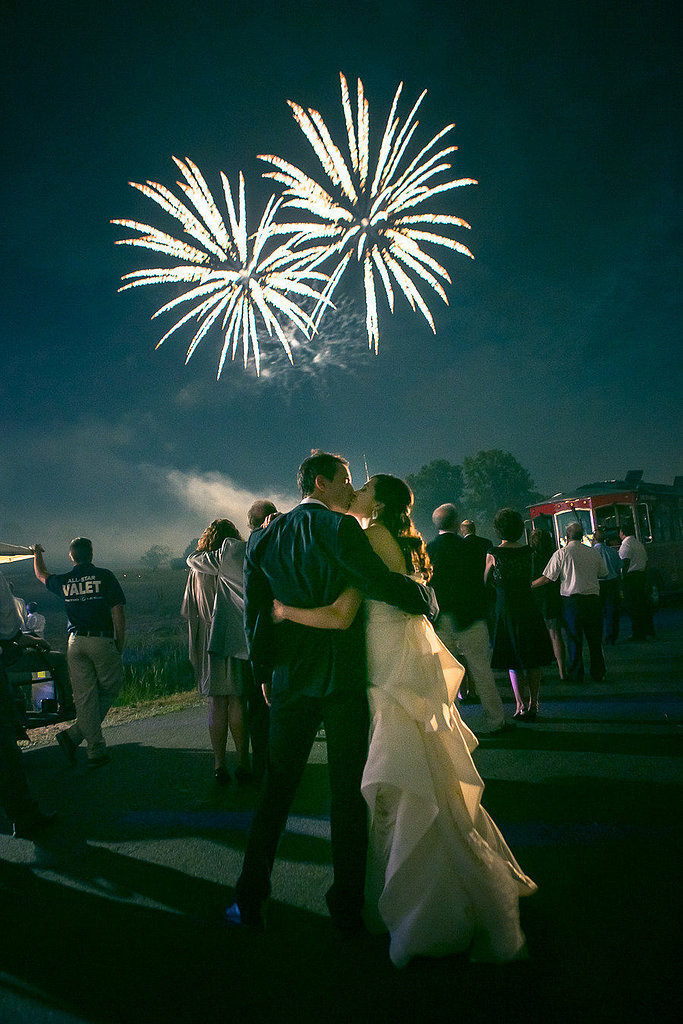 The happy pair smooched under the fireworks. Photo by Heather Waraksa via Style Me Pretty
