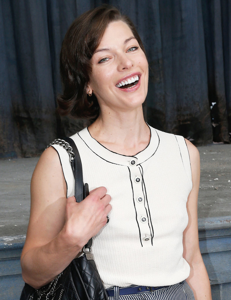 Milla Jovovich was all smiles at the Chanel Haute Couture show. She wore her hair with a deep side part and soft waves. Her makeup was minimal with a glossy lip.