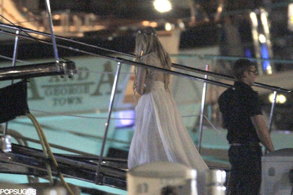 Avril Lavigne boarded a yacht in a flowing dress.