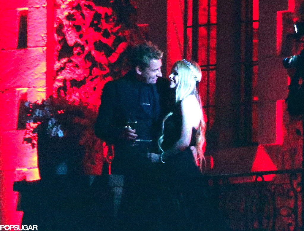 Avril Lavigne and Chad Kroeger smiled on the balcony.