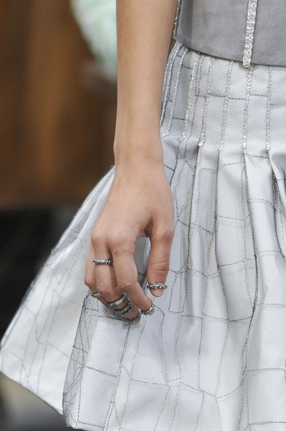 The nails at Chanel, painted with the brand's Nail Colour in Ballerina ($27), were kept light and neutral to match the androgynous makeup look . . . and to show off the amazing knuckle rings on the models' fingers.