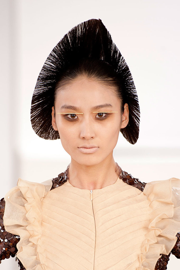 At Julien Fournié, the models appeared to be from another galaxy. Lips were covered with makeup and eyes were smudged with a mix of earth tones.