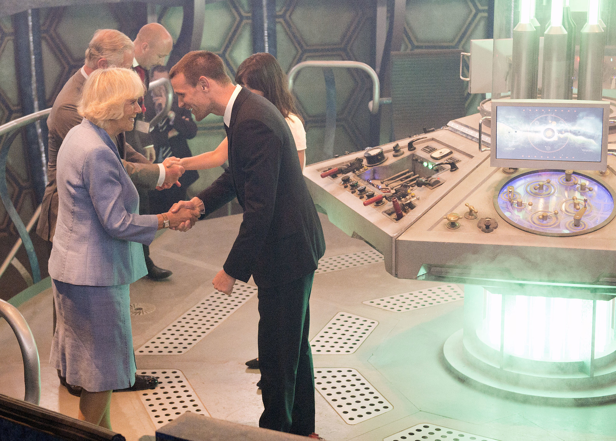 The Doctor greeted the duchess aboard the TARDIS.