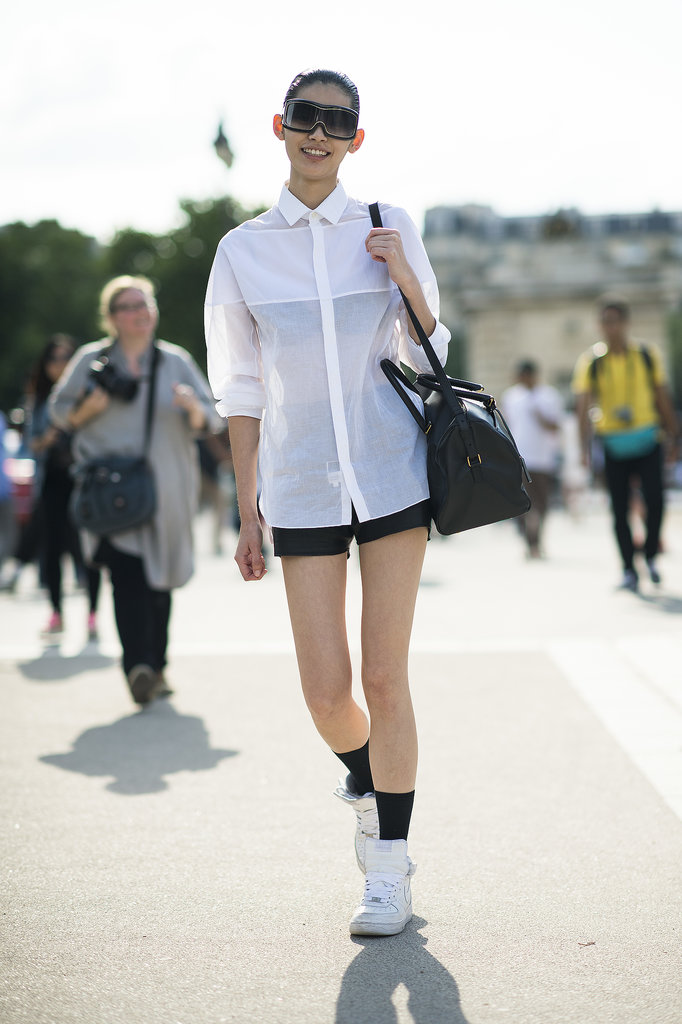 A white button-down shirt and shorts got an upgrade with visor shades and old-school kicks. Source: Le 21ème | Adam Katz Sinding