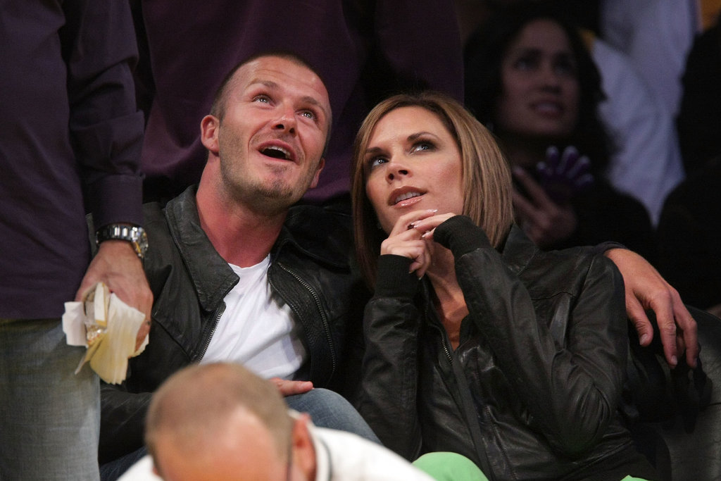 David and Victoria cuddled up at a Lakers game in May 2008.