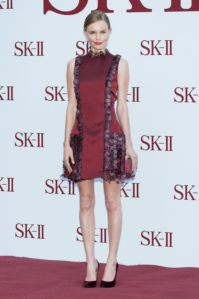 Kate Bosworth was a true lady in red at an event in South Korea, accessorizing her ruffled brick-hued Christopher Kane dress with matching Bionda Castana pumps and a Swarovski clutch.