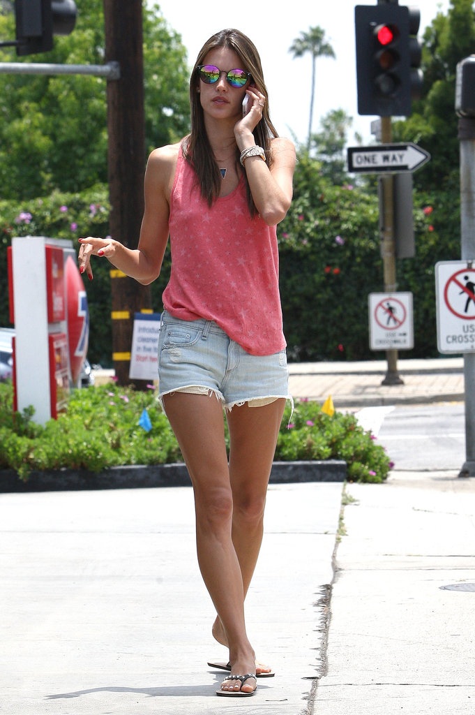 Alessandra stuck to her denim cutoffs, a star-print tank, and mirrored sunglasses in LA.