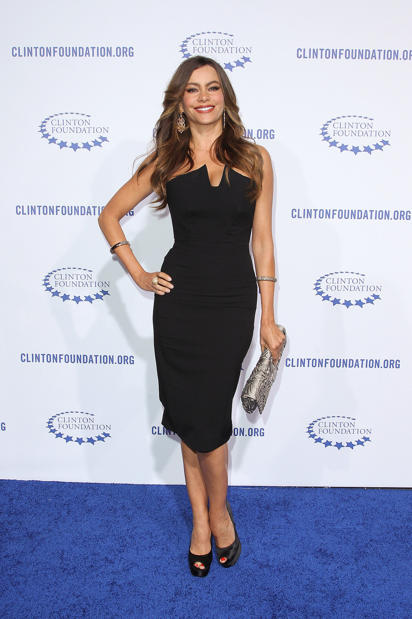 "Sofia nailed the balance of sophisticated and sexy in a sharply structured black sheath and satin pumps for the Clinton Foundation's ""A Decade of Difference"" Gala in October 2011."