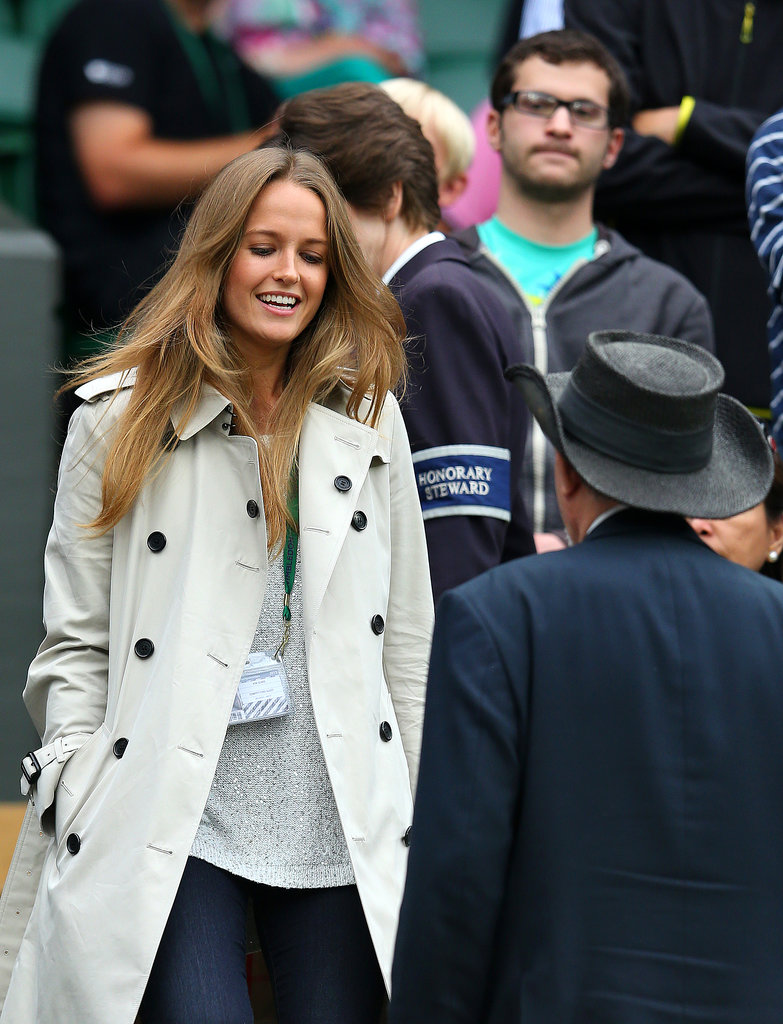 Wimbledon, long regarded as a classic British affair with unpredictable weather, is nothing that a smart trench can't handle. Kim covered up on day five with the Brit standby.
