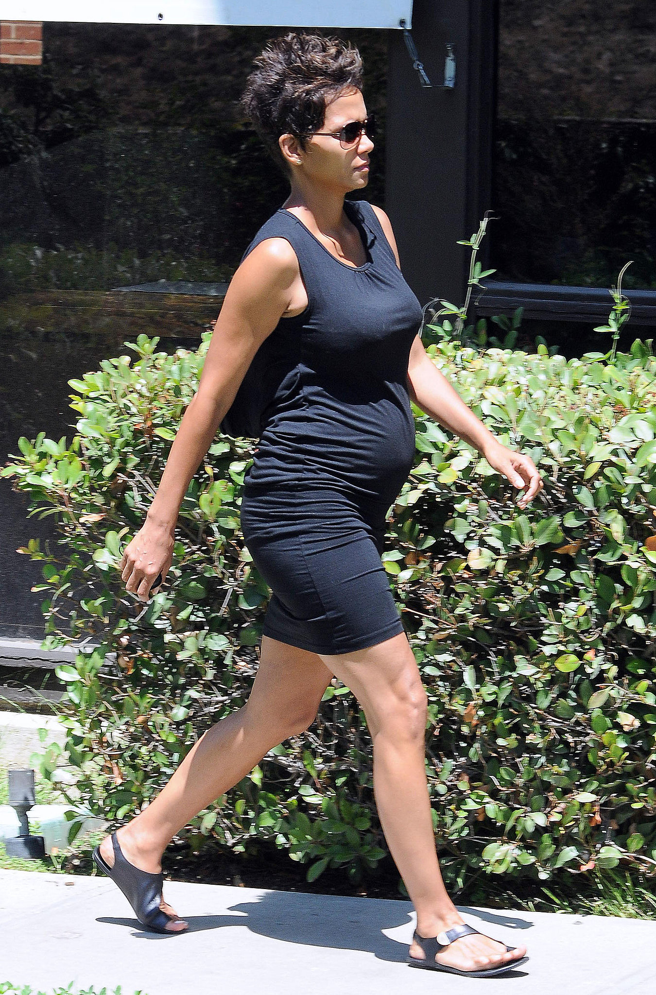 Halle's draped black minidress showed off her growing bump. We love that she finished with a pair of off-kilter black sandals. Follow this style formula with just two pieces: an LBD and cool black flats.
