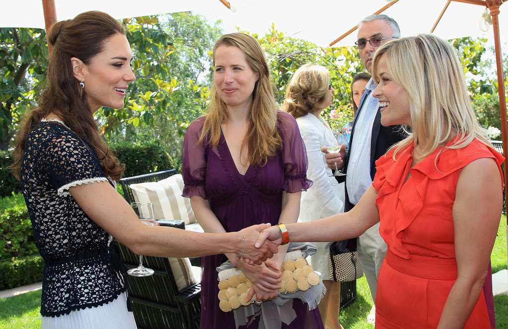 Reese Witherspoon and Kate Middleton shook hands in Beverly Hills at the reception to mark the launch of Tusk's US Patron Circle in July 2011.
