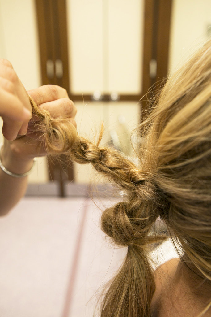 Continue to knot the hair tightly until you reach the end. Secure with an elastic.