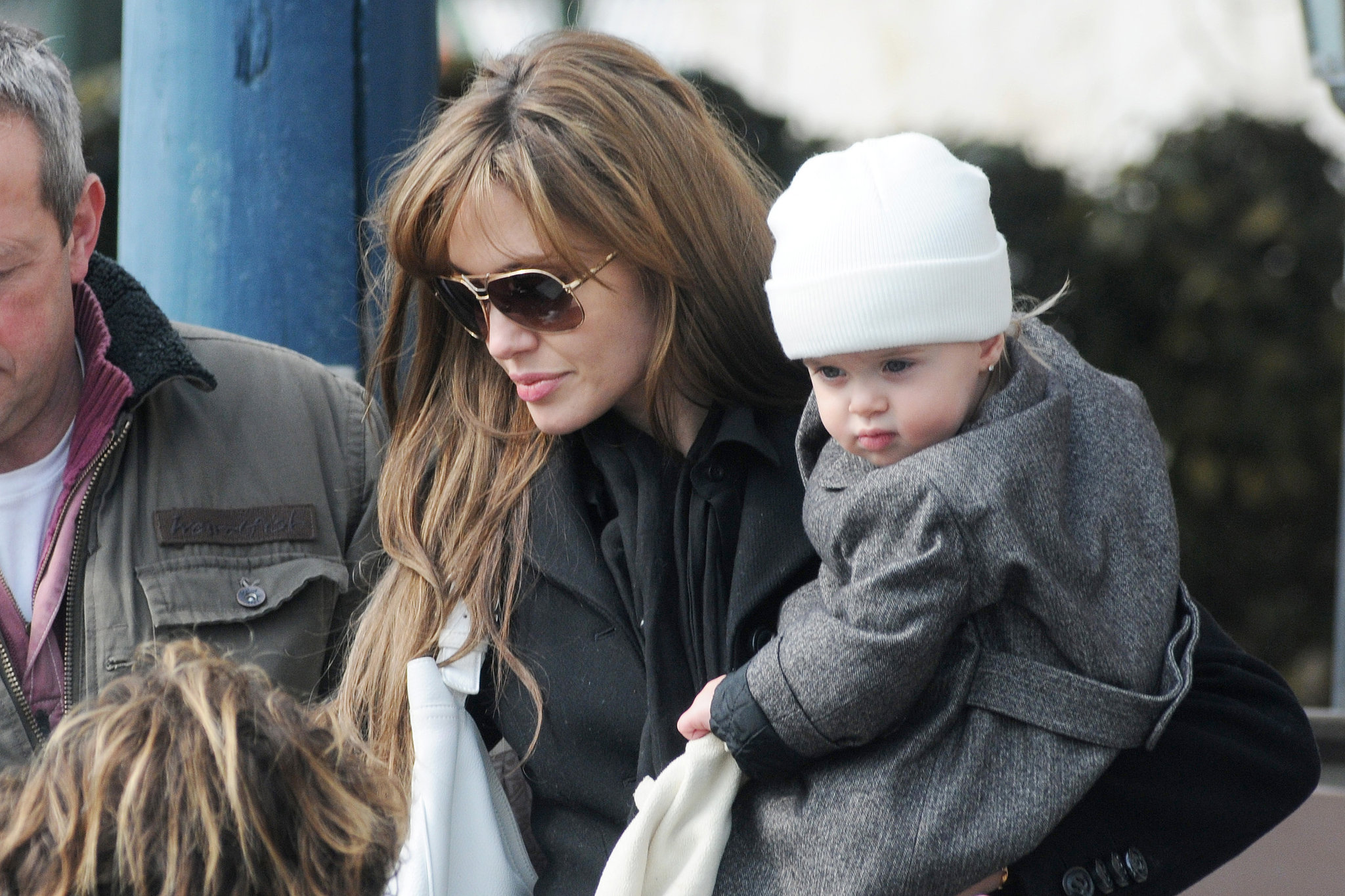 Vivienne Jolie-Pitt accessorized with earrings and a cap while out in Venice with Angelina Jolie in March 2010.