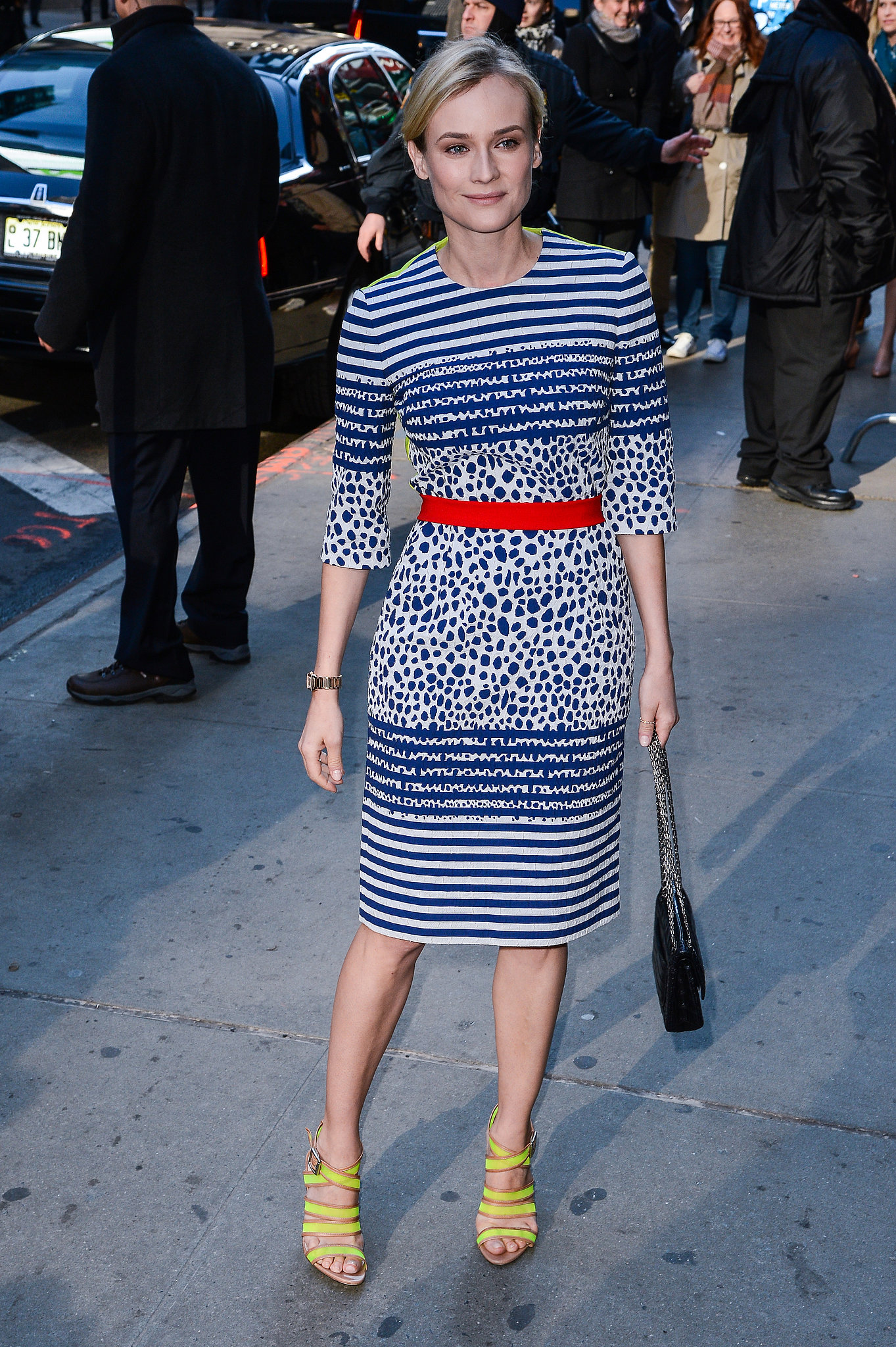 While leaving the Good Morning America studios, Kruger looked pristine in Preen, brightening the city streets with navy, red, and neon yellow.