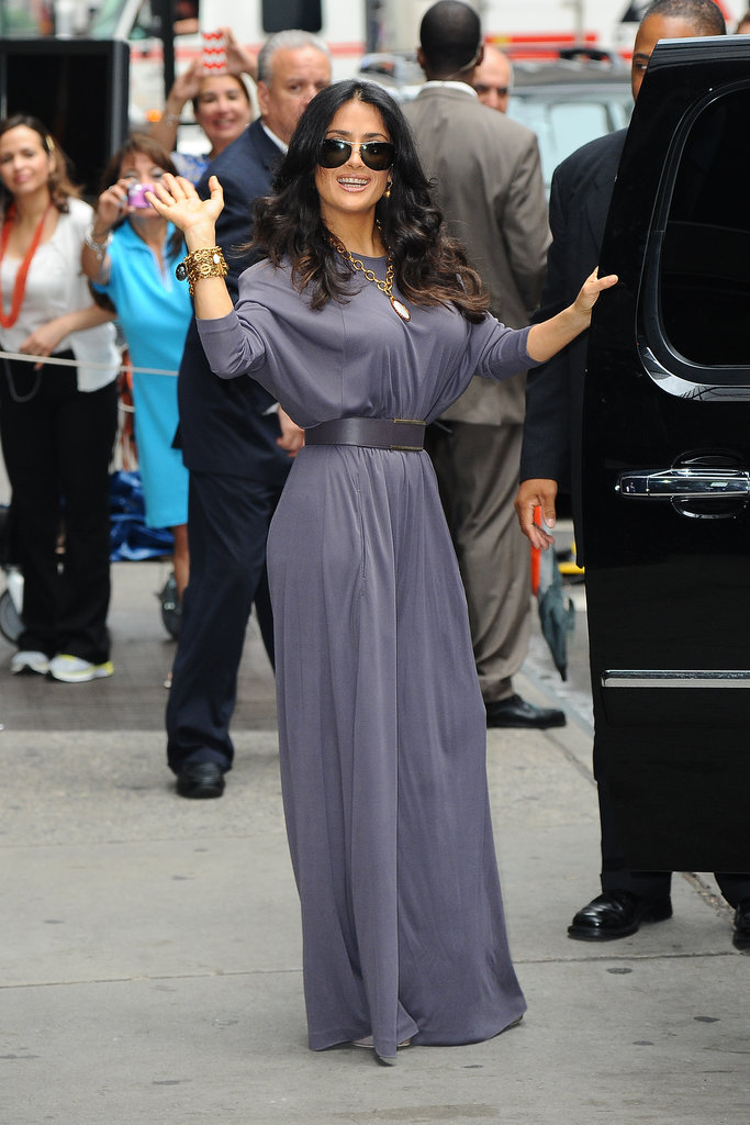 Yet another ensemble Salma donned for her Grown Ups 2 promotions in NYC was a gray wide-leg jumpsuit, which she belted at the waist to give it a more streamlined look. Chunky gold jewels made the look even more glamorous.