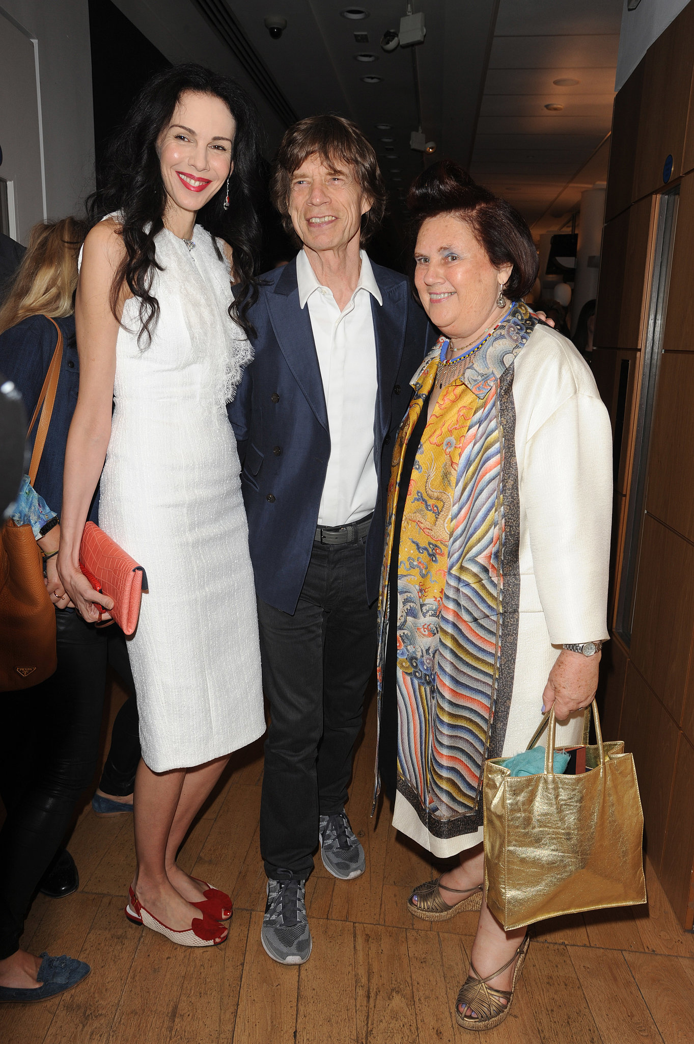 L'Wren Scott and Mick Jagger joined Suzy Menkes for the opening reception of her Christie's collection in Lond