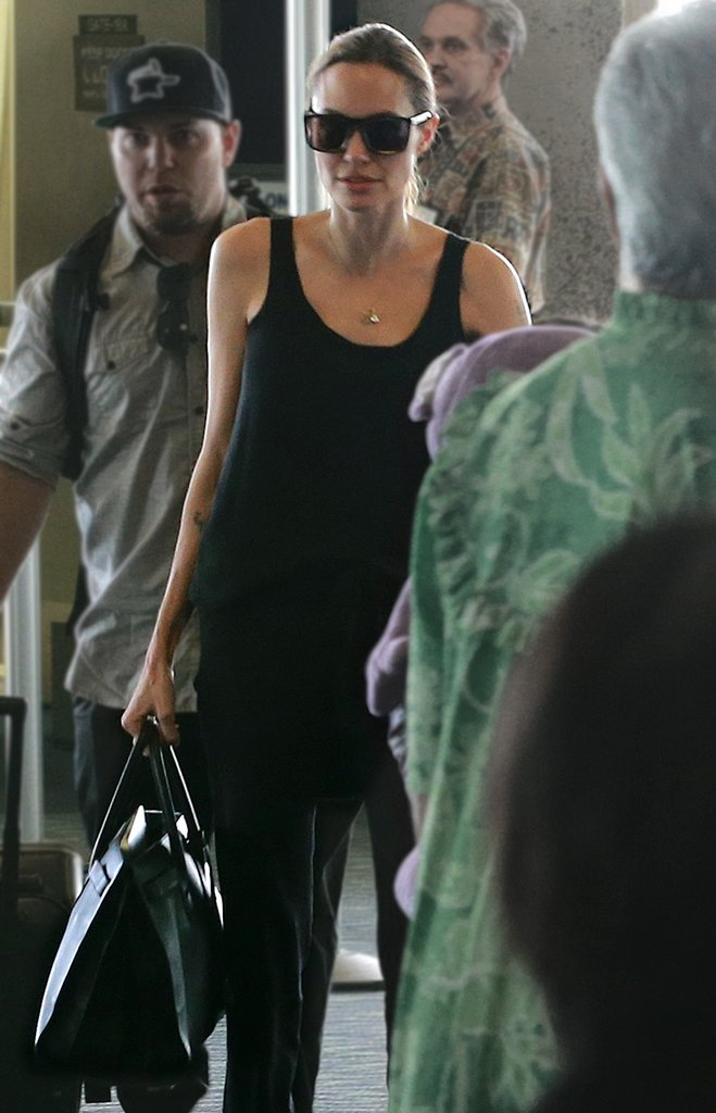 Along with black tanks and bottoms, it seemed to become a constant in her traveling wardrobe. Photo courtesy of Saint Laurent