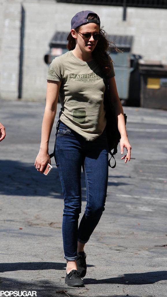 Kristen Stewart wore jeans and a green t-shirt.