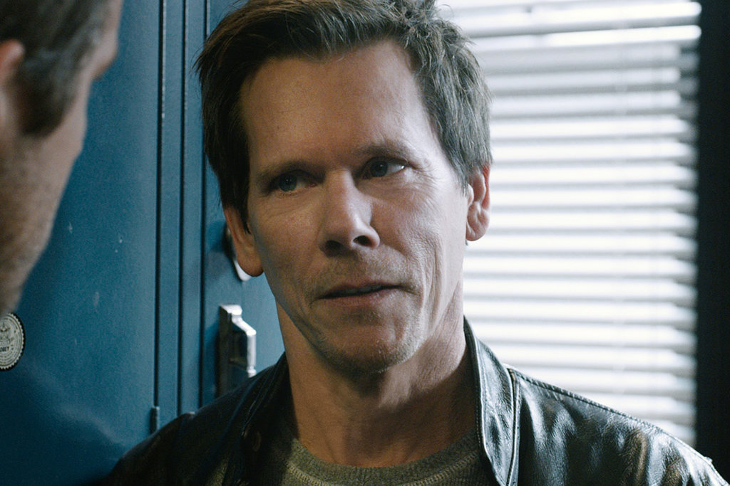 It's Kevin Bacon! And he certainly does not look like one of the good guys.