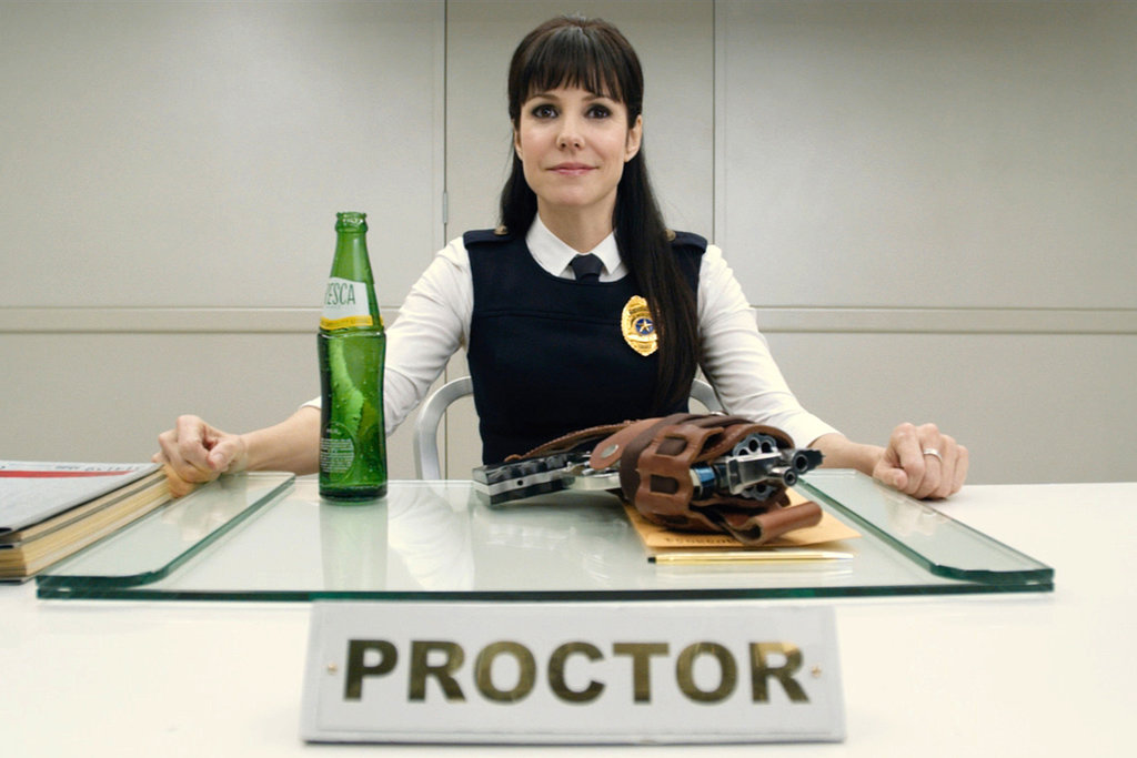 Mary-Louise Parker looks dapper as the Proctor of the afterlife.