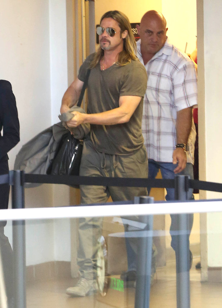 Brad Pitt Puts His Pecs on Display at LAX