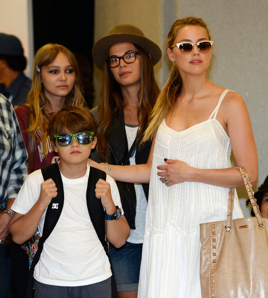 Amber Heard helped usher Johnny Depp's children through the airport in