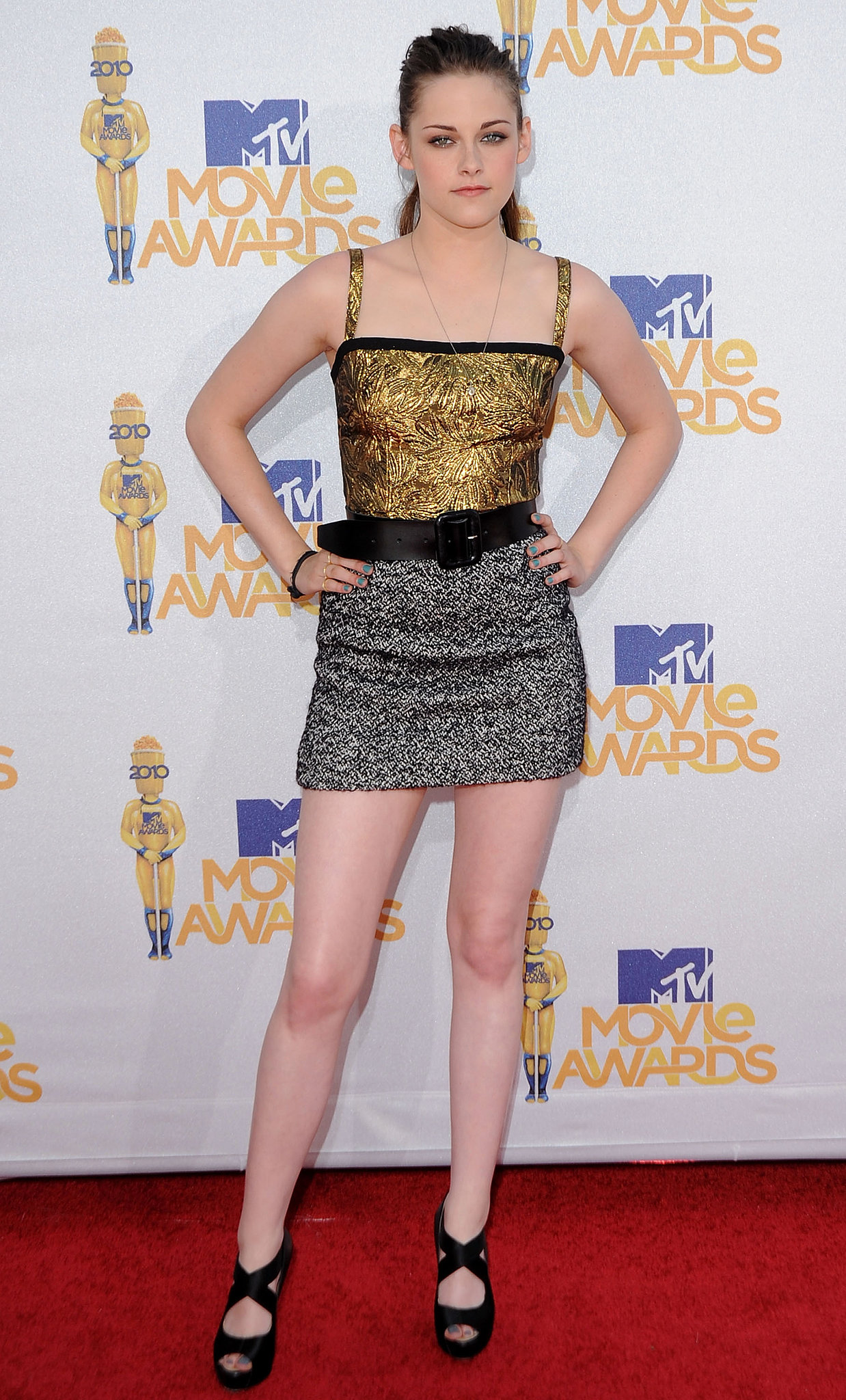 For the 2010 MTV Movie Awards, the actress styled a sassy gold and black Dolce & Gabbana mini with crisscross black sandals for a uniquely glam look.