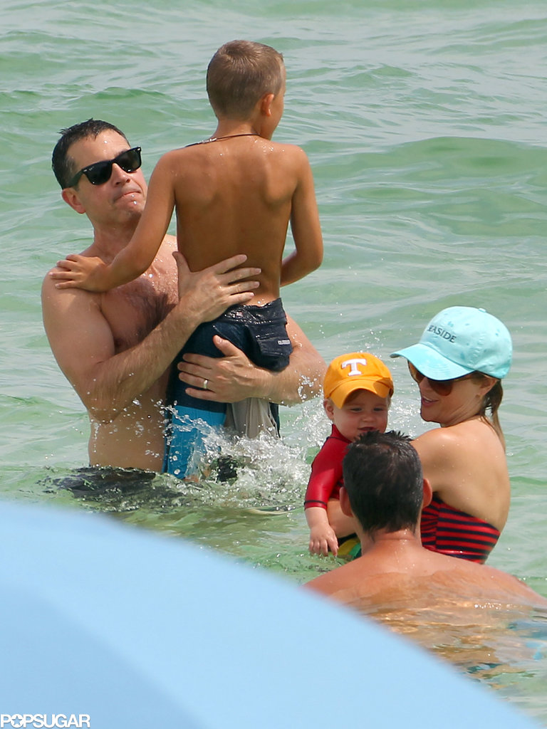 Reese Witherspoon and Jim Toth played with their kids in the water.