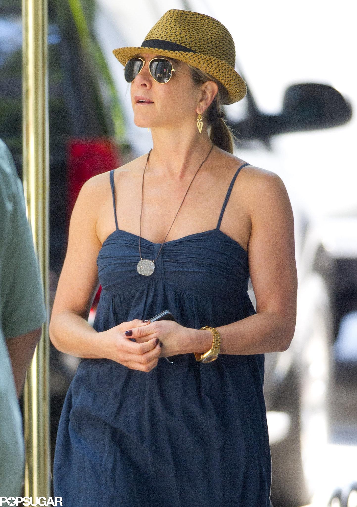 Jennifer Aniston beat the NYC heat on July 16 in a fedora.