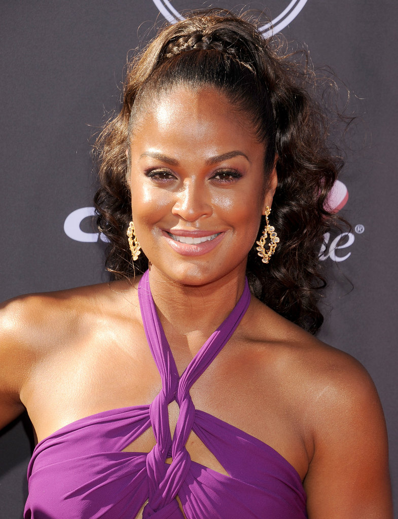 A curly ponytail with a braid roped around the base was Laila Ali's style for the night. She also wore golden eye shadow to complement her bronzed complexion.