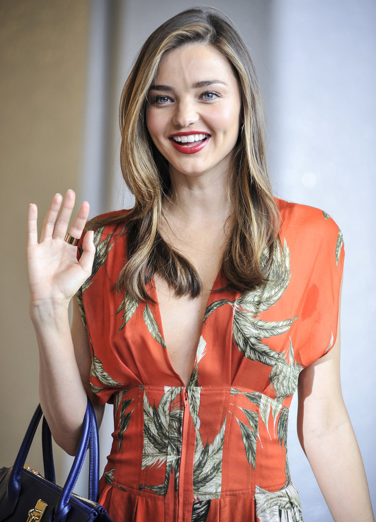 Miranda Kerr waved at fans in the airport.