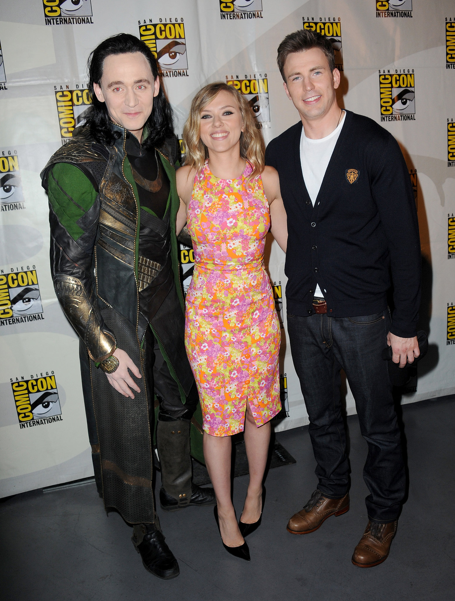 Scarlett Johansson had the pleasure of posing with her Captain America: The Winter Soldier costar Chris Evans as well as Thor: The Dark World's Tom Hiddleston — dressed as his character, Loki — at the Marvel panel in 2013.
